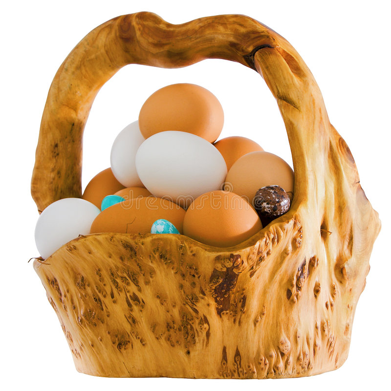 Natural Wooden Basket Of Fresh Brown and White Organic Eggs royalty free stock image