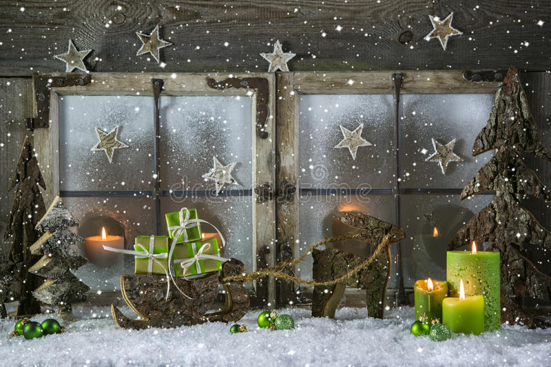 Natural wooden christmas decoration with candles and green presents. royalty free stock photos