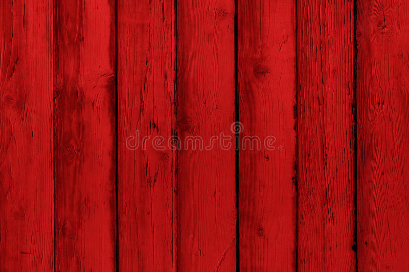 Natural wooden painted red boards, wall or fence with knots. Abstract textured background, empty template. Painted wooden planks stock photography
