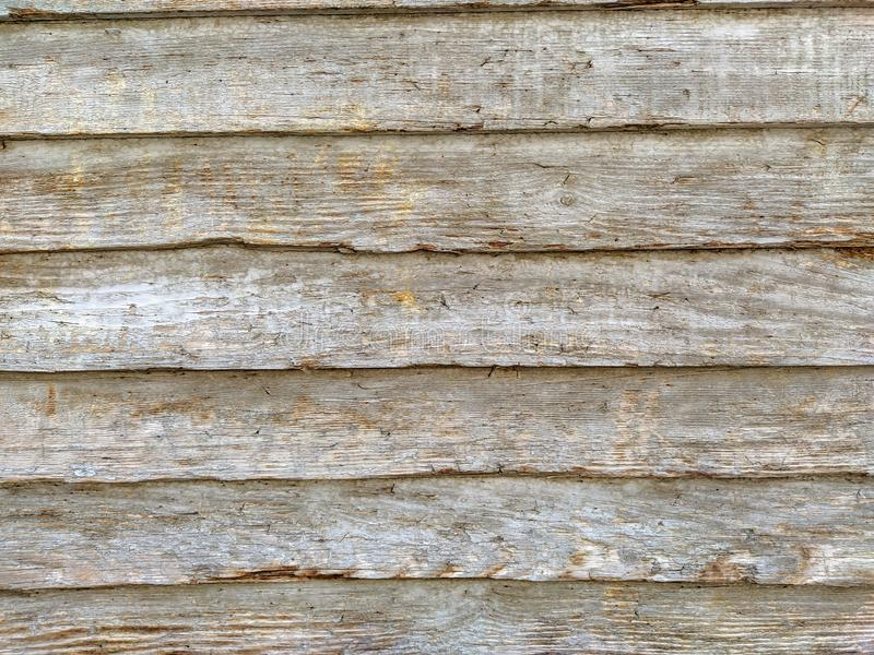 Natural wooden planks stacked horizontally making a board with rough texture and wood patterns for surface coverage stock photos