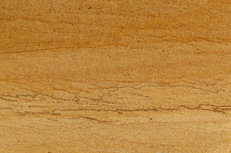Natural yellow rough sand stone texture close up background stock images