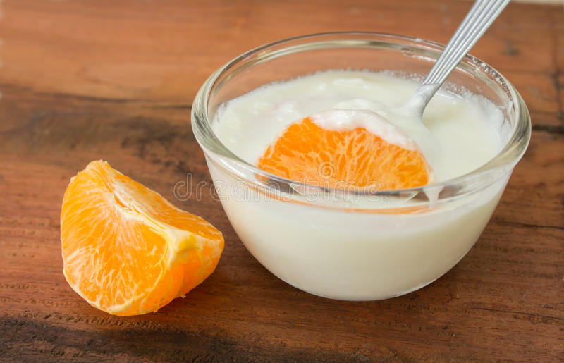 Yogurt With Orange Jam In A Glass Cup On A Rustic Wooden