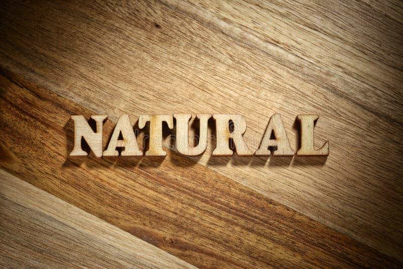 Naturale di parola fatto con le lettere di legno immagine stock libera da diritti