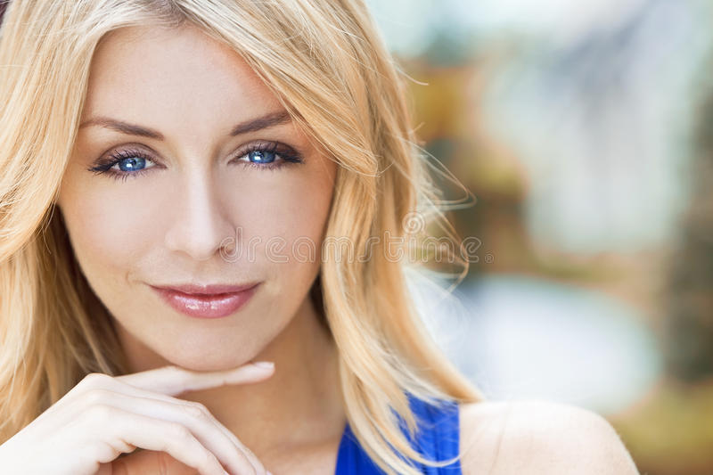 Naturally Beautiful Blond Woman With Blue Eyes royalty free stock photography