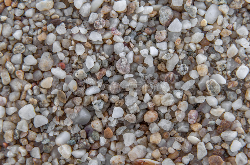 Naturally rounded gravel at sea shore, nature background texture stock photo
