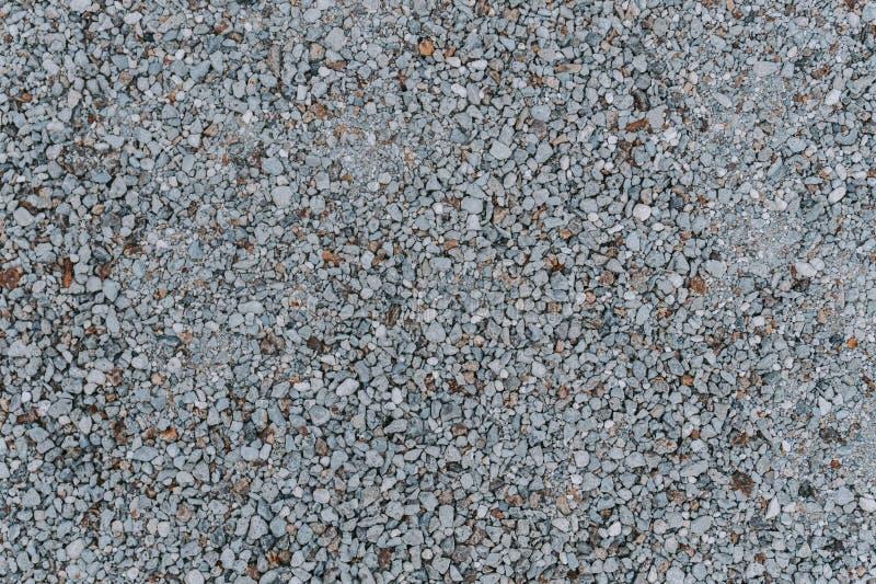 Naturalnego małego kamienia tła popielaty kolor struktura fizyczna zdjęcia stock