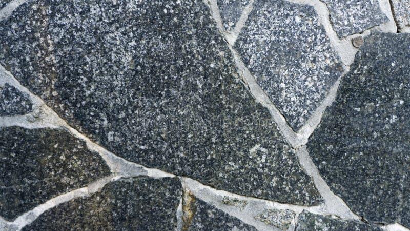 Naturalny kamienny granitowy tło Jaskrawa ciężka popielata granit skały tekstura Popielaty granitu kamienia tło obraz stock