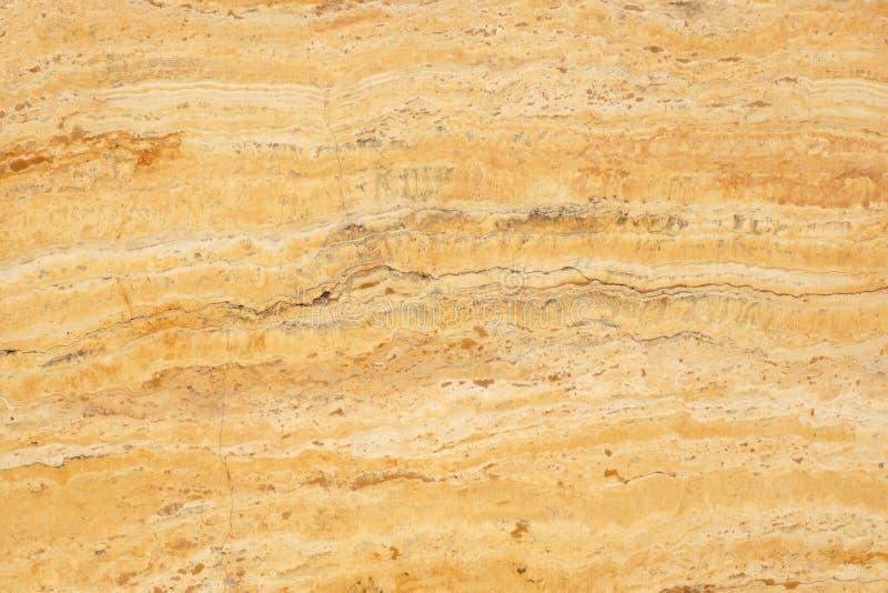 Naturalny kamienny naciekowy żółty kolor z ciekawym wzorem, nazwany Travertino Giallo fotografia royalty free