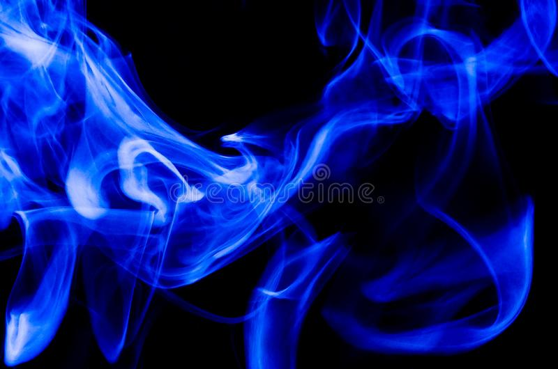 Nature Abstract: The Delicate Beauty and Elegance of a Wisp of Blue Smoke. Nature Abstract: The Delicate Beauty and Elegance of a Fragile Wisp of Blue Smoke stock image