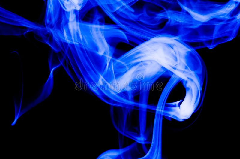 Nature Abstract: The Delicate Beauty and Elegance of a Wisp of Blue Smoke. Nature Abstract: The Delicate Beauty and Elegance of a Fragile Wisp of Blue Smoke stock photography