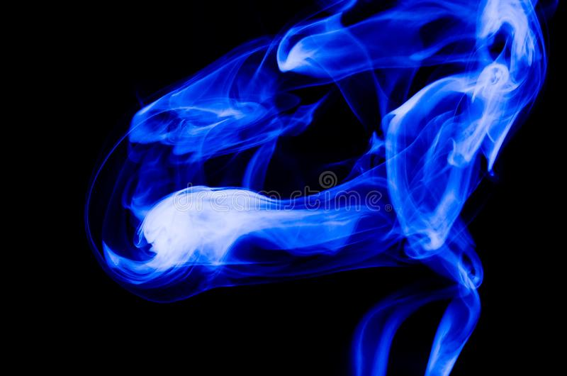 Nature Abstract: The Delicate Beauty and Elegance of a Wisp of Blue Smoke. Nature Abstract: The Delicate Beauty and Elegance of a Fragile Wisp of Blue Smoke royalty free stock images