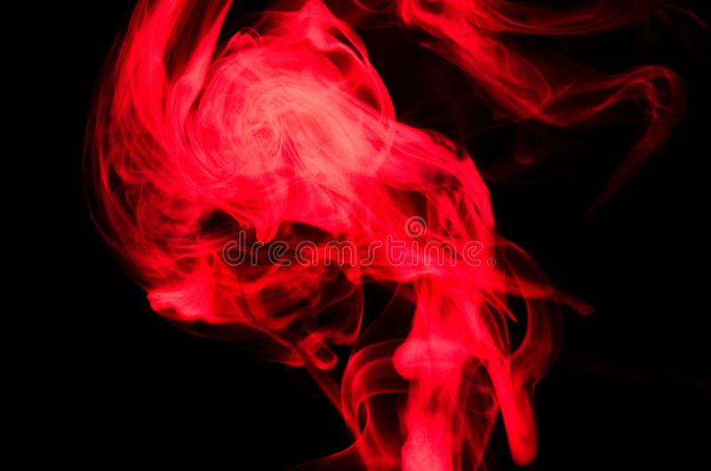 Nature Abstract: The Delicate Beauty and Elegance of a Wisp of Red Smoke stock image