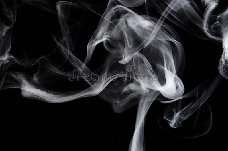 Nature Abstract: The Delicate Beauty and Elegance of a Wisp of White Smoke. Nature Abstract: The Fragile Delicate Beauty and Elegance of a Wisp of White Smoke royalty free stock images