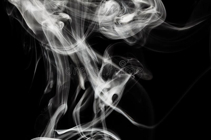 Nature Abstract: The Delicate Beauty and Elegance of a Wisp of White Smoke. Nature Abstract: The Delicate Beauty and Elegance of a Fragile Wisp of White Smoke royalty free stock image