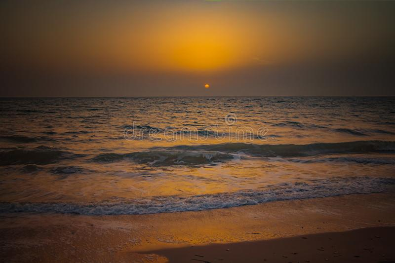 Nature background of amazing beach sunset with endless horizon and incredible foamy waves. It is Atlantic ocean in tropical. Paradise in Senegal, Africa. There stock images
