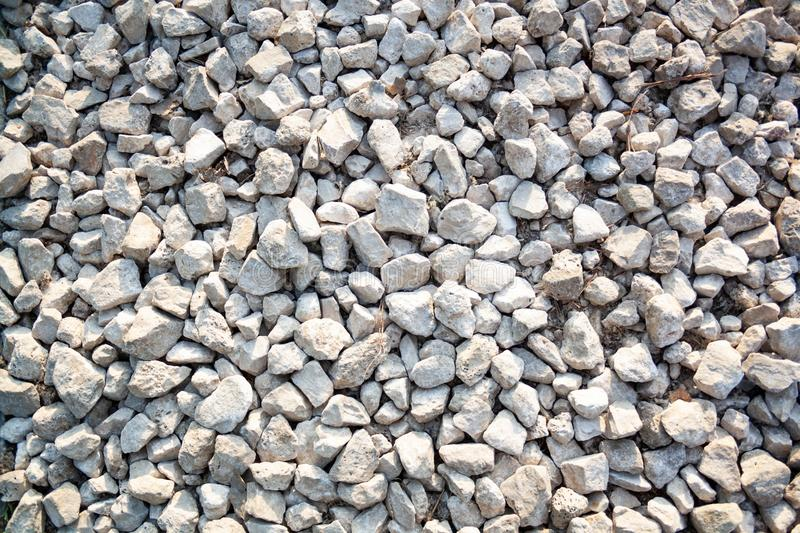 Nature background from gray sea pebbles. Sandy and rocky texture. Rocky wallpaper royalty free stock image