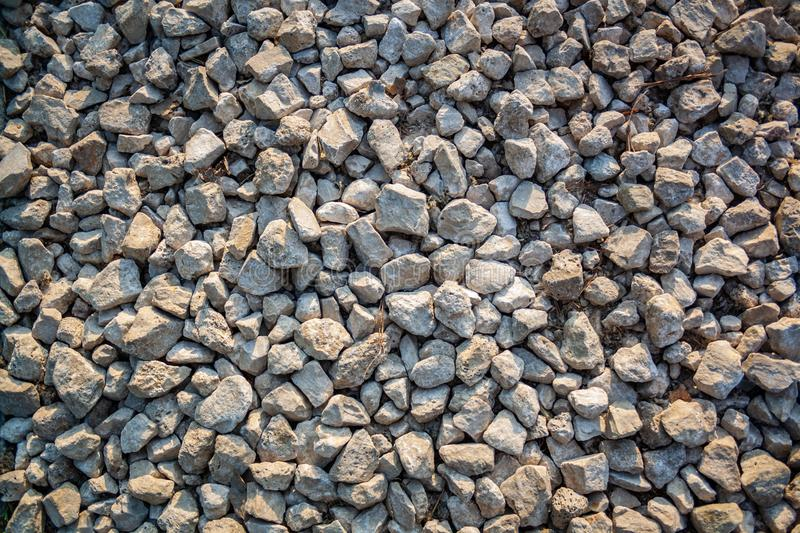Nature background from gray sea pebbles. Sandy and rocky texture. Rocky wallpaper stock photography