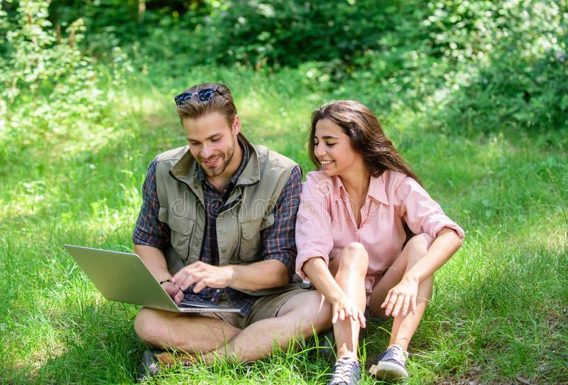 Nature best workspace. Couple youth spend leisure outdoors with laptop. Modern technologies give opportunity to be. Online and work in any environment stock image