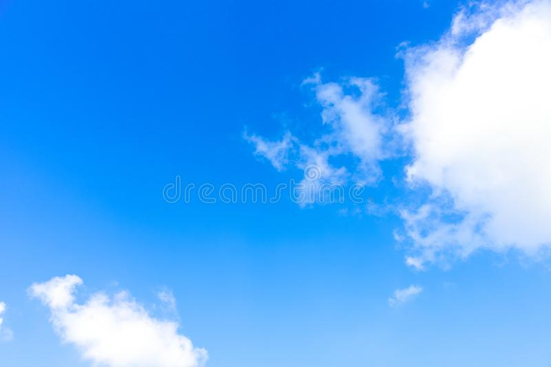 Nature Bright blue Sky with white clouds on blackground. Beautiful sky and clouds in the afternoon royalty free stock photo