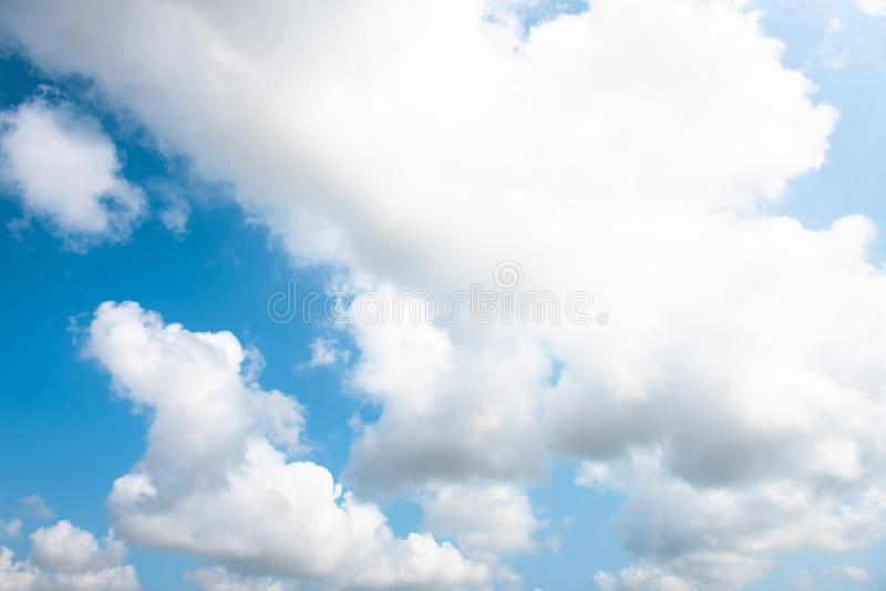 Nature Bright blue Sky with white clouds on blackground. Beautiful sky and clouds in the afternoon stock photo