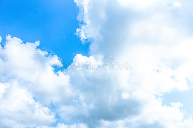 Nature Bright blue Sky with white clouds on blackground. Beautiful sky and clouds in the afternoon stock image