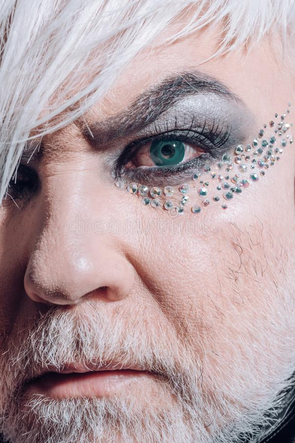 Nature chooses who will be transgender. Fashion male eye makeup. Transgender man wear eyeshadows and eyebrow makeup. Male makeup look. Fashion is part of our stock photography