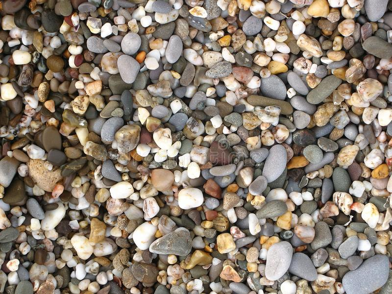 Nature colorful pebbles beach stones. Mix nature colorful Pebbles Beach Stones background wallpaper texture royalty free stock photography
