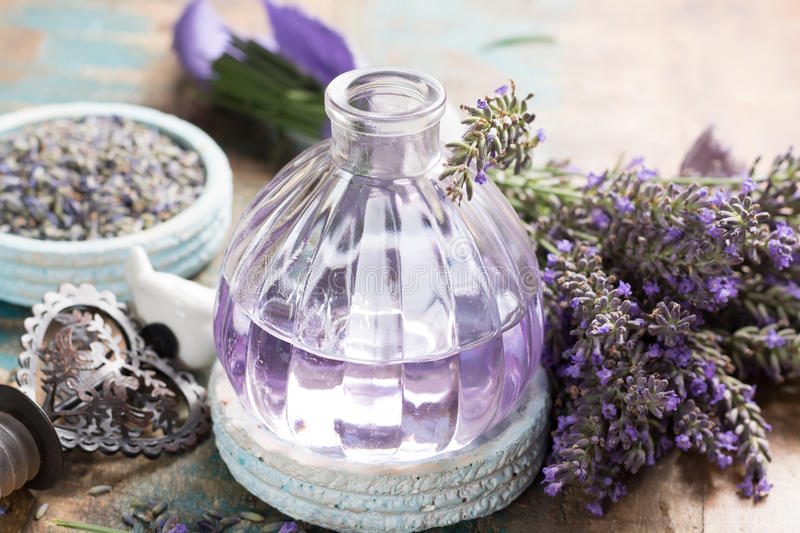 Nature cosmetics, handmade preparation of essential oils, parfums, creams, soaps from fresh and dried lavender flowers, French ar royalty free stock photos