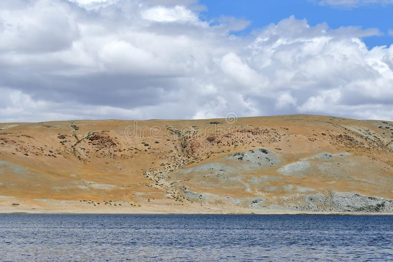 Nature-created image of Buddha`s eyes on the mountain on the shore of the sacred lake Manasarovar royalty free stock photos