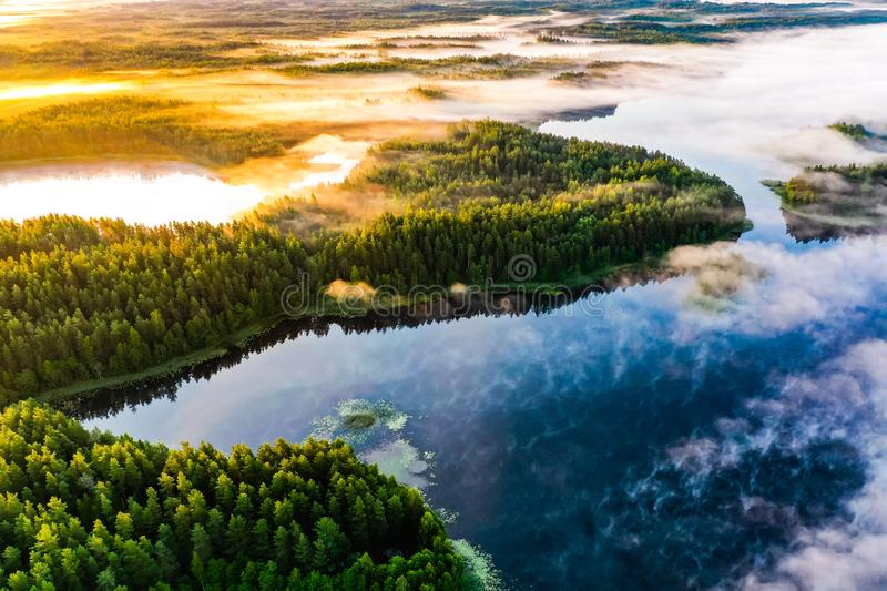 Nature exploration concept. Lake system surrounded with green forest, aerial landscape stock images