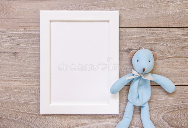 Nature garden retro wood vintage table white frame mock up cute. Blue bear doll stock photography