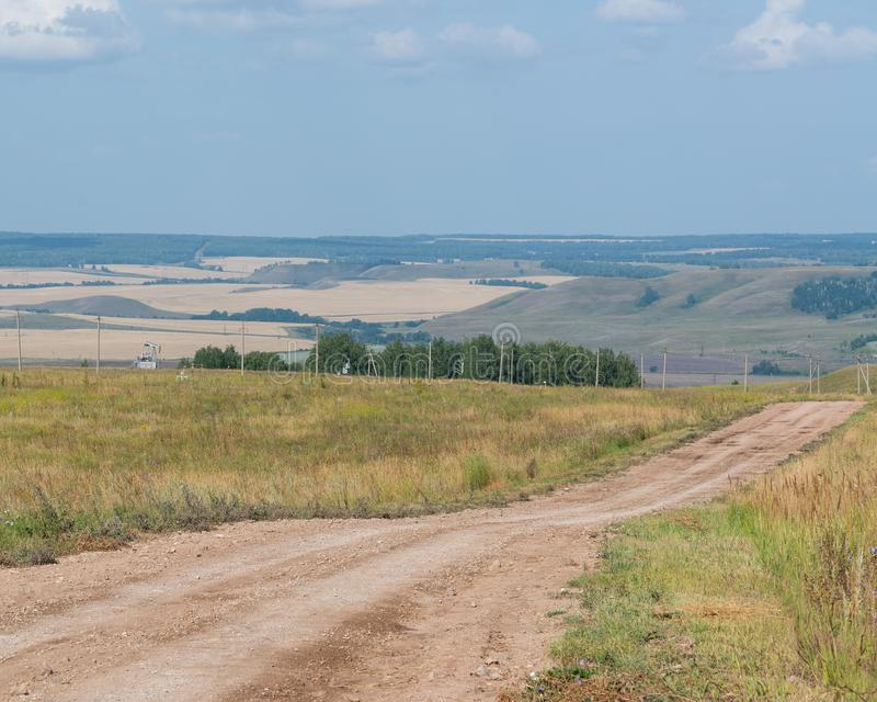 Nature. Good weather. Sunny day. Country road. royalty free stock photography