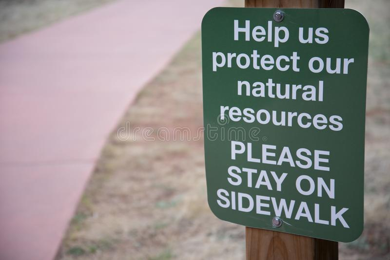 Nature hiking walking trail sign to stay on the trail royalty free stock images