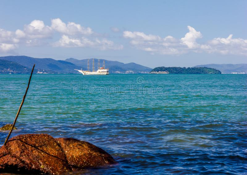Nature island barco. Blue island  stones sky day stock photography
