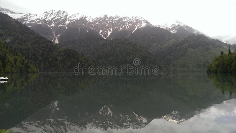 nature,lake,mountains,Abkhazia,mirror,mist,mystery royalty free stock photography