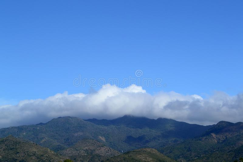 Nature landscape. Clouds hung over the mountains. Trinidad, Cuba. Sky, cloudy, hill, high, background, view, tranquility, meditation, you, outdoor, outdoors royalty free stock photo