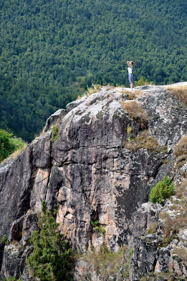 Nature landscape. Silhouette of a girl in the rock in mountain royalty free stock photography