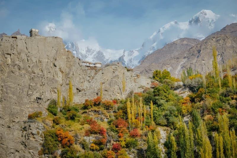 Altit fort on hill top against snow capped Ultar Sar mountain peak in Karakoram range royalty free stock photos