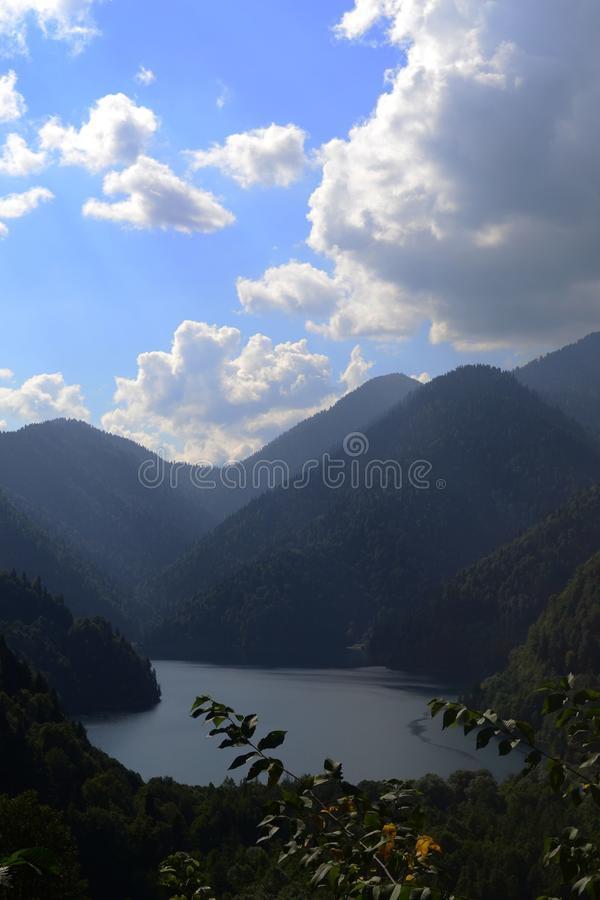 Nature landscape. View of the lake Ritsa in the Caucasian mountains. Abkhazia. Background, outdoors, sky, clouds, hill stock photos