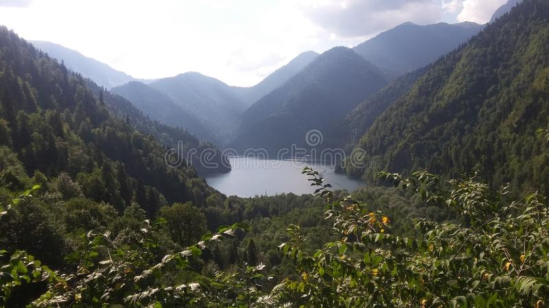 Nature landscape. View of the lake Ritsa in the Caucasian mountains. Abkhazia. Water, green, forest, natural, background, outdoor, famous, place stock photos