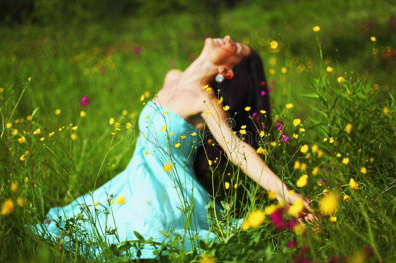 Nature love. Woman on flower field royalty free stock photos