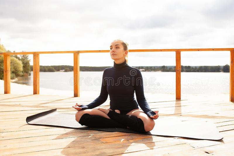 Nature meditation concept. Woman do yoga in lotus position. Nature meditation concept. Wellness and Health care, Woman meditating. Healthy lifestyle Yoga royalty free stock image