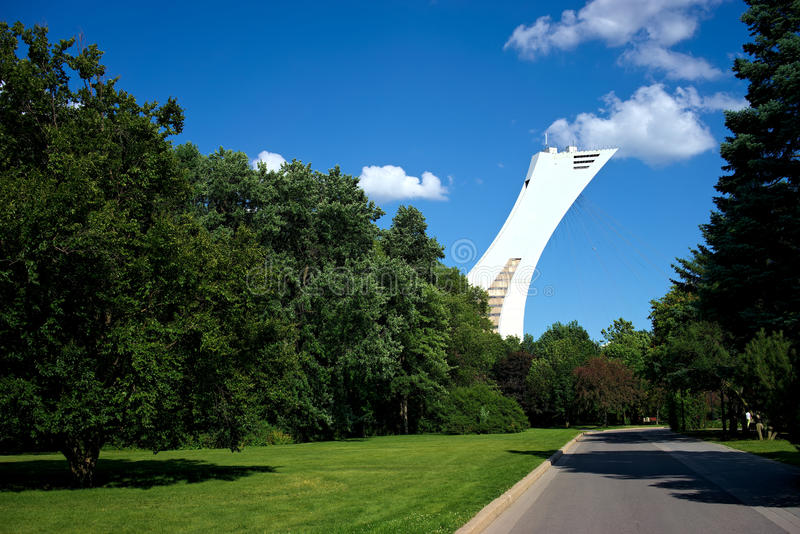 Nature meets modern architecture in Montreal, Quebec, Canada. From the green paths at the Botanical Garden, one can see the high tower of the Olympic Stadium stock photography