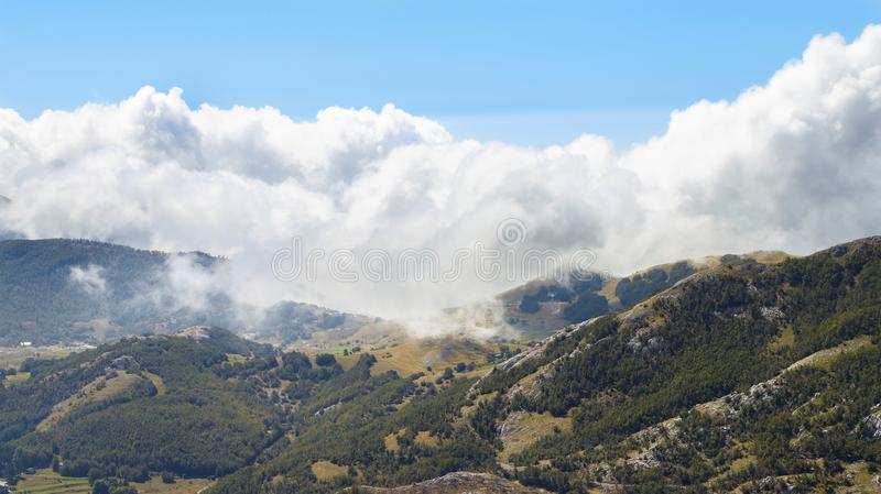 Nature of Montenegro. Clouds floating on mountains and forest.  royalty free stock images