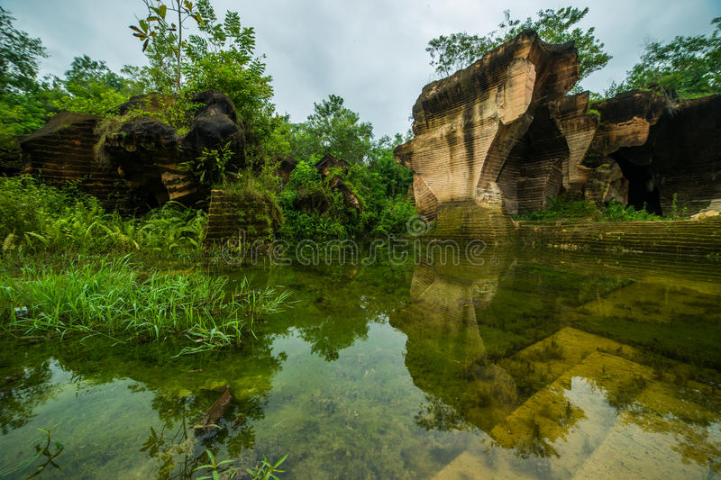 Nature outdoor park with pond water in limestone mining hill ancient work place at bukit kapur. indonesia. Nature outdoor park with pond water in limestone stock image