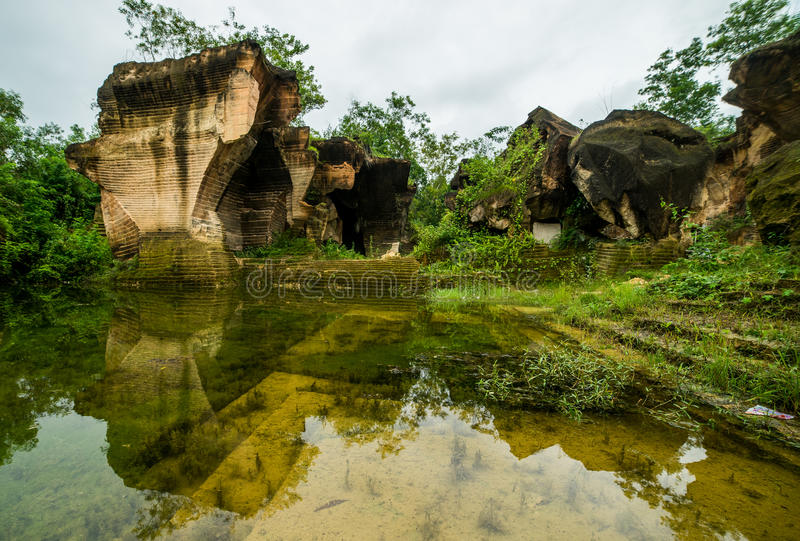Nature outdoor park with pond water in limestone mining hill ancient work place at bukit kapur. indonesia. Nature outdoor park with pond water in limestone royalty free stock images