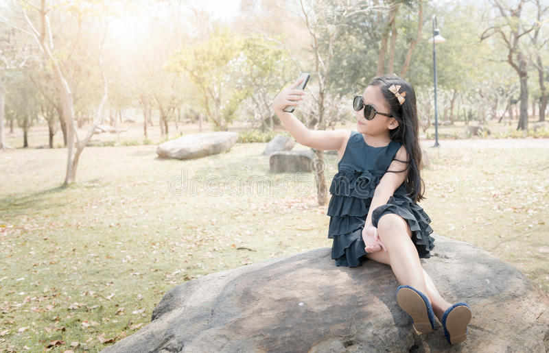 Nature outdoor technology social concept. cute girl taking selfie. royalty free stock photography
