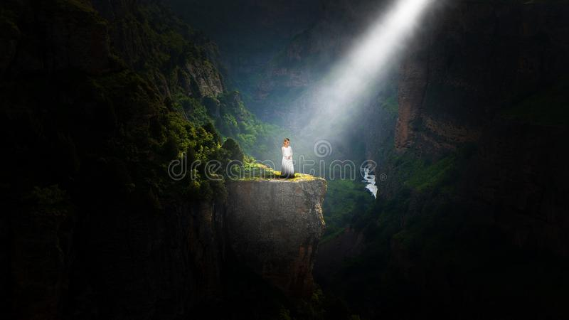 Nature, Peace, Hope, Love, Spiritual Rebirth, Girl. A young girl stands on a cliff in nature in an abstract concept canyon for peace, hope, love, and spiritual royalty free stock images