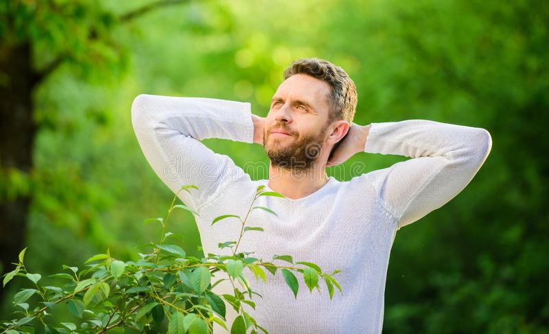 Nature peaceful environment. Natural beauty remedies. Keep it healthy way. Nature relax spa resort. Feel power of nature. Man handsome bearded guy morning royalty free stock photo