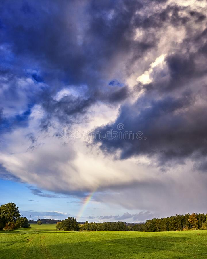 Nature photo field of grass and Rainbow and blue sky with clouds landscape. Background, tree, summer, dramatic, sun, spring, mecklenburg-vorpommern, green stock photos